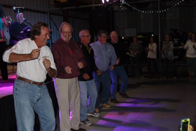 Line Dancing men at fish tale marina-friends of the arts-concert series