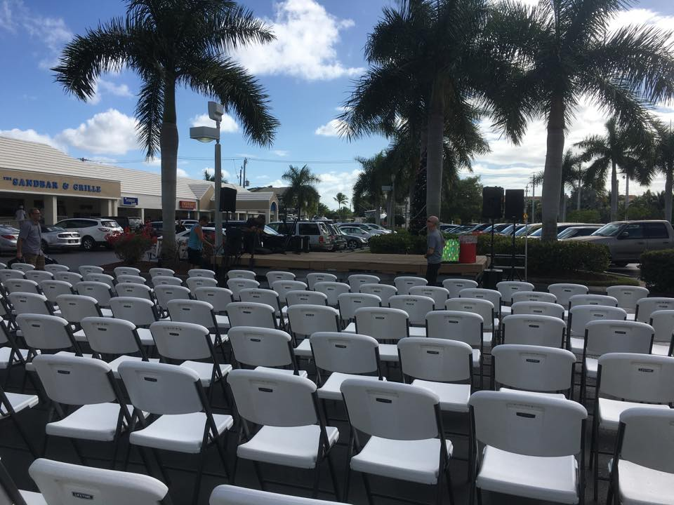 concert set up-chairs in santini plaza parking lot