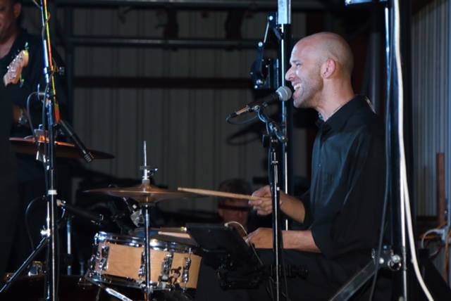 drummer singing at concert