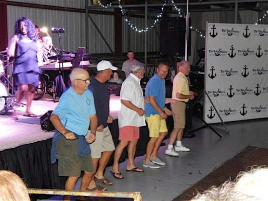 men line dancing at the concert series