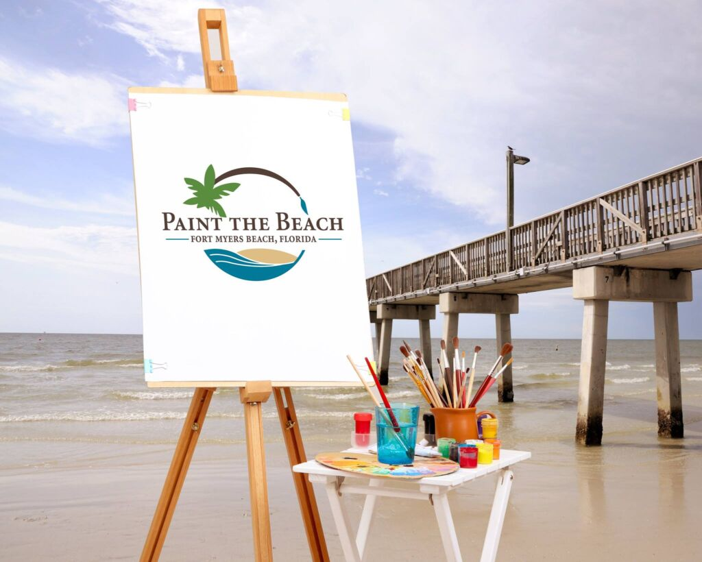 paint the beach fmb-promo sign near pier